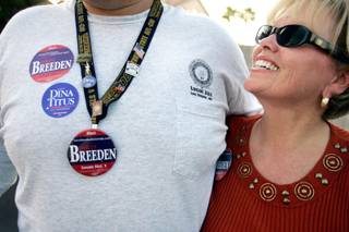 Ed Long, a volunteer and Shirley Breeden supporter, hugs Breeden in September 2008 as they canvass a neighborhood in state Senate District 5 in Henderson. A recently retired school administrator and a political novice, Breeden stresses her experience as a soccer mom and her