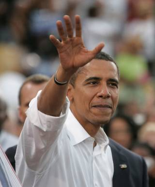 Barack Obama waves to supporters Wednesday, Sept. 17, 2008, at Cashman Field in Las Vegas.