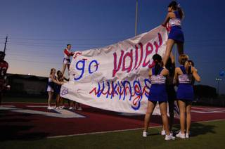 Valley High School cheerleaders wait to welcome the Vikings to the field on Friday.