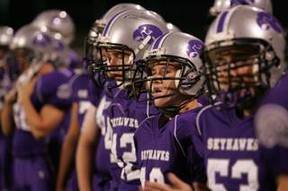 Silverado football players look on from the sidelines during Friday's home game against Liberty.