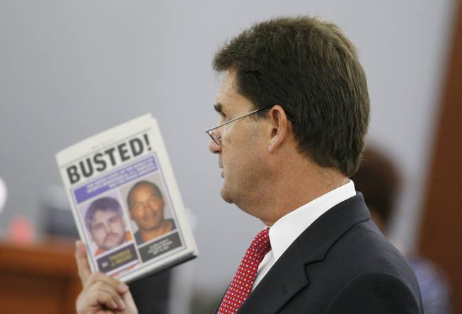 O.J. Simpson's attorney Yale Galanter holds a book written by witness Thomas Riccio in court during Simpson's trial in Las Vegas, Monday, Sept. 22, 2008. Simpson faces 12 charges, including felony kidnapping, armed robbery and conspiracy.