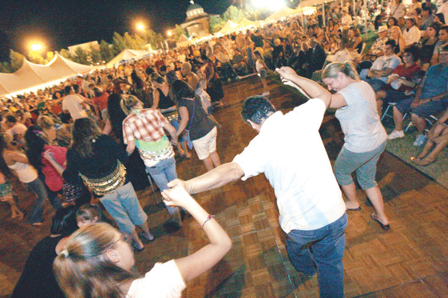 People dance to Greek music during the annual Greek Food Festival at St. John the Baptist Greek Orthodox Church.