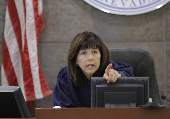 Judge Jackie Glass gestures during O.J. Simpson's trial Tuesday, Sept. 23, 2008, in Las Vegas. Simpson faces 12 charges, including felony kidnapping, armed robbery and conspiracy.