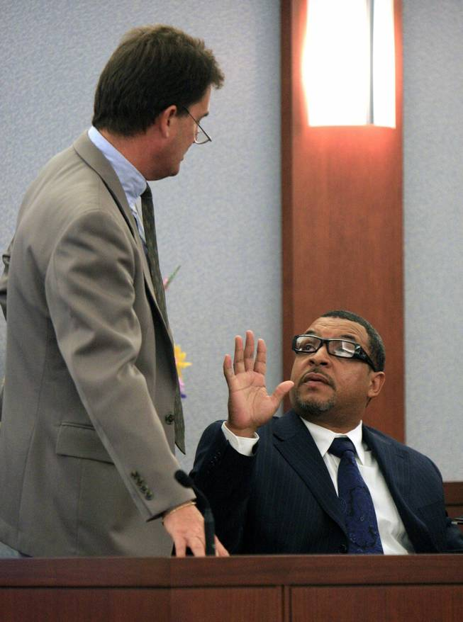 Walter Alexander, right, asks O.J. Simpson's attorney Yale Galanter to back away as Galanter cross examines him during Simpson's trial in Las Vegas, Wednesday, Sept. 24, 2008. Simpson faces 12 charges, including felony kidnapping, armed robbery and conspiracy.