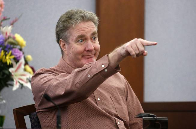"Memorabilia dealer Alfred Beardsley points to O.J. Simpson as he testifies during Simpson's trial at the Clark County Regional Justice Center in Las Vegas, Nevada Thursday, September 25, 2008. Simpson and co-defendant Clarence ""C.J."" Stewart are standing trial on 12 charges, including felony kidnapping, armed robbery and conspiracy related to a 2007 confrontation with Beardsley and another sports memorabilia dealer in a Las Vegas hotel."