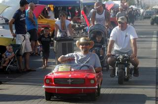 Roger Nitti, now quite grown up, drives the 1965 Ford Mustang Jr. go-kart his father bought him when he was 9 years old up Water Street during the Super Run Car Show on Friday.