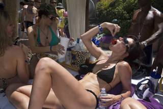 A UCLA law student, Carrie Richeu, nibbles strawberries poolside with friends during a Rehab in late June.