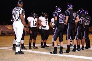 Durango and Clark captains meet for the coin toss at the beginning of Friday night's game at Durango High School.