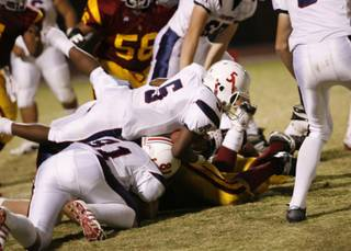 Liberty running back Ty Byrd looks for yardage against Del Sol Friday.