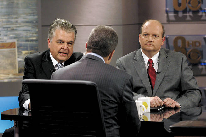 "Steve Sisolak, left, and Brian Scroggins talk to moderator Jon Ralston during a taping of ""Face to Face With Jon Ralston"" on Friday."