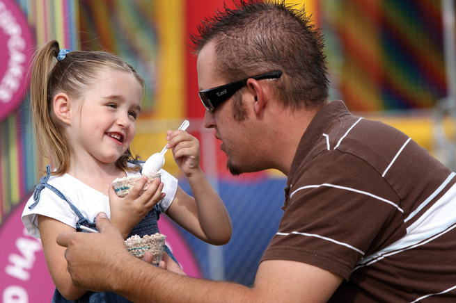 Jared Evans listens to his daughter share funny stories while eating Dippin' Dots at The Bite of Las Vegas 2007.