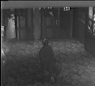 A photo from a surveillance video shows a suspect wearing a motorcycle helmet fleeing after robbing the Las Vegas Hilton sports book Friday, Sept. 26, 2008.