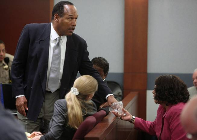 O.J. Simpson, left, and his sister Carmelita Durio appear during Simpson's trial at the Clark County Regional Justice Center, Wednesday, Oct. 1, 2008 in Las Vegas. Simpson faces 12 charges, including felony kidnapping, armed robbery and conspiracy.