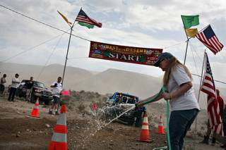 Under cloudy skies, the race start is watered down as racers start 30 seconds apart in the Bilek Racing Silver State 300 near Alamo, Nev., on Saturday, Sept. 27.
