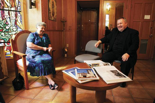 Lynda Ballard and the Rev. Timothy Wehn enjoy talking about the 100-year history of St. Joan of Arc parish.