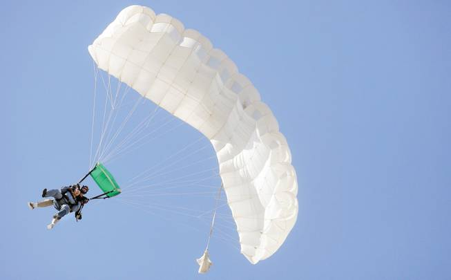 Skydivers free fall during a trip with Skydive Las Vegas at Boulder City Airport Sept. 20.