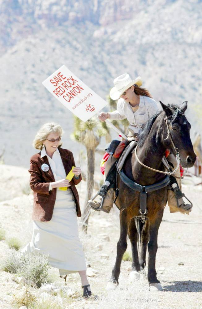 State Sen. Dina Titus, left, talks with Gina Mamusia before speaking at a rally in 2003 to save Red Rock Canyon. Titus is widely credited with leading the fight fight to protect the canyon. Her other accomplishments include saving a 2005 comprise property tax cap.