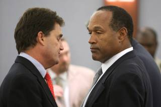 O.J. Simpson, right, with his lawyer Yale Galanter wait for a verdict of guilty on all counts to be read following his trial at the Clark County Regional Justice Center in Las Vegas on Friday, Oct. 3, 2008. The verdict comes 13 years to the day after Simpson was acquitted of murdering his ex-wife Nicole Brown Simpson and Ron Goldman.