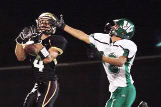 Faith Lutheran wide receiver Don Pearson completes a long pass during Friday's home football game against Virgin Valley.