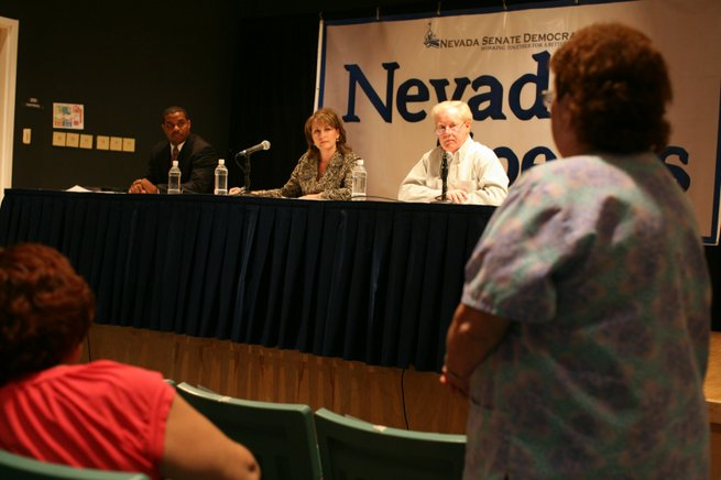 In a town hall meeting Thursday at Irwin Molasky Middle School in Las Vegas, Democrats, from left, Senate Minority Leader Steven Horsford, state Senate candidate Allison Copening and state Sen. Mike Schneider listen to constituents' suggestions on how to lead the state out of its budget crisis.