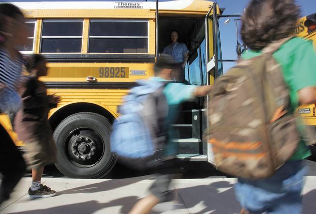 Kathy L. Batterman Elementary School students scamper to their buses to make their way home after a long day of school.