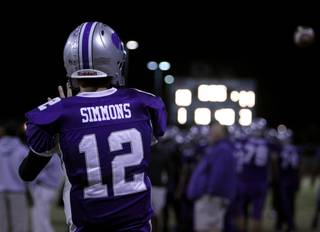 Silverado's Kyle Simmons warms up on the sideline before Friday's game against Foothill.