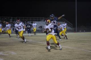 Earnest Hall rushes the ball during Friday night's game against Coronado.