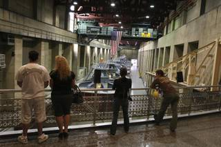 Water conservationists, from left, Doug Myers, Tammy Myers, Cat Sawai and Tui Anderson observe the seven-story-high hydroelectric generators while touring the power plant at the Hoover Dam with the WaterSmart Innovations Conference on Friday.