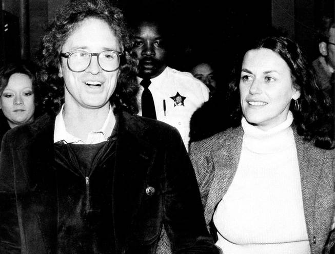 William Ayers accompanies Bernardine Dohrn as the former radical enters the Criminal Courts Building in Chicago in 1980 to surrender to authorities.
