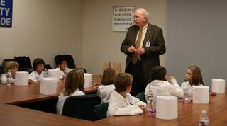 Clark County School District food service director Charles Anderson talks with 20 fifth-graders about nutrition before a tour of the CCSD central kitchen and lunch.