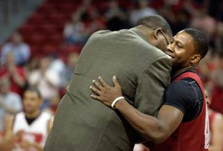 UNLV player Wink Adams, right, hugs Sidney Green, a former UNLV player and the second all-time leader in points scored, during a ceremony at the UNLV basketball team's first practice at the Thomas & Mack Center on Friday.