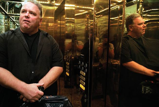 Burke rides the elevator in the Golden Nugget, an early part of his 5 1/2 minute dash to Fitzgeralds, where he will perform his second show of the night, as he does seven nights a week.