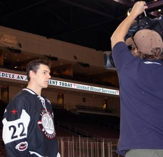 Las Vegas Wranglers center Chris Neiszner prepares for a television interview during the Wranglers' media day at Orleans Arena on Monday.
