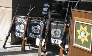 Eight rifles, a chrome pistol and a revolver were among the items confiscated by law enforcement Tuesday. The weapons were used by the Mongols motorcycle gang.