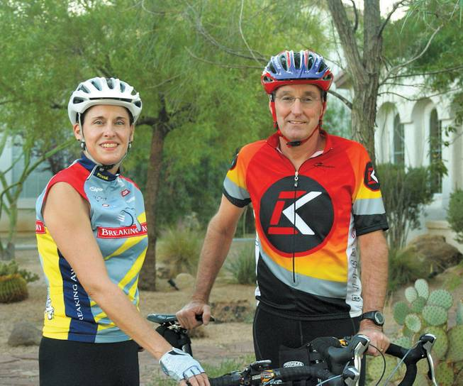 Don and Michele Shafe pose for a photo before a training session for the 118-mile RTC Viva Bike Vegas ride this Saturday.