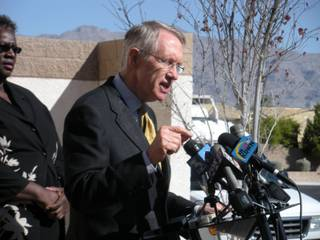 Sen. Harry Reid addresses reporters on a plan to end the housing crisis for Las Vegas. Reid is standing outside a foreclosed home in the hardest hit neighborhood, zip code 89131.