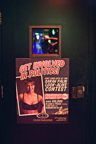 A sign on a door advertises a Republican vice presidential candidate Sarah Palin look-alike stripper contest at the Club Paradise strip club in Las Vegas. Contestants competed for $10,000 in prize money and a trip to Washington, D.C., for the presidential inauguration.