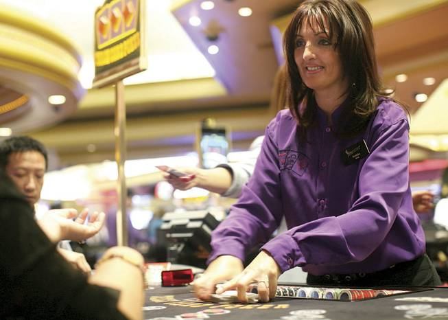 Bosiljka Jevremovic deals three-card poker Thursday at the Stratosphere. Some dealers complain about wages and strict new management; others say they are more appreciated and slackers aren't getting away with not pulling their weight.
