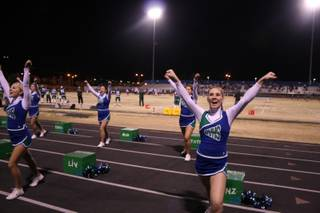 Green Valley cheerleaders keep up the pep during Friday's game. Green Valley defeated Silverado 31-13.
