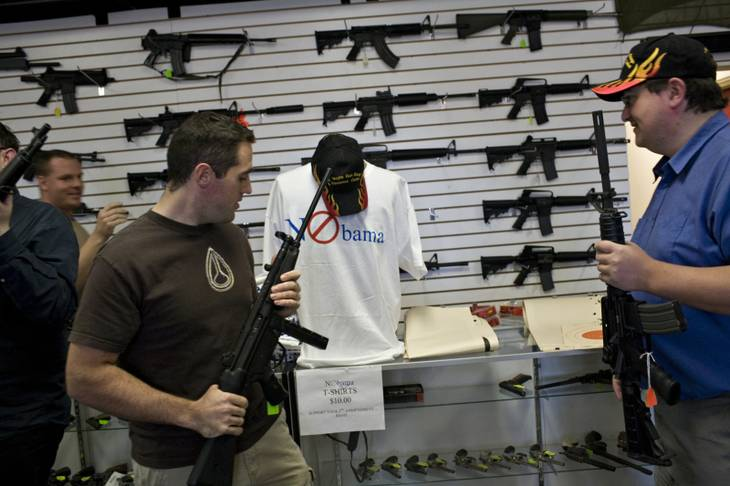 "Canadian tourists Colin Grosh, left, and David Mitchnick check out the wares Wednesday at the Las Vegas Gun Range & Firearms Center. The NRA says that in the past year it has registered more than 1 million gun owners to vote, and at the center ""NObama"" T-shirts are hot items, with most of the 300 ordered having been sold."