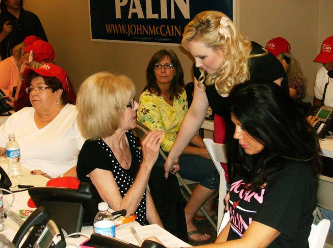 Meghan McCain, center, daughter of presidential candidate Sen. John McCain, greets volunteer Sunnie Dotson, 56, of Henderson at the McCain campaign headquarters Monday.
