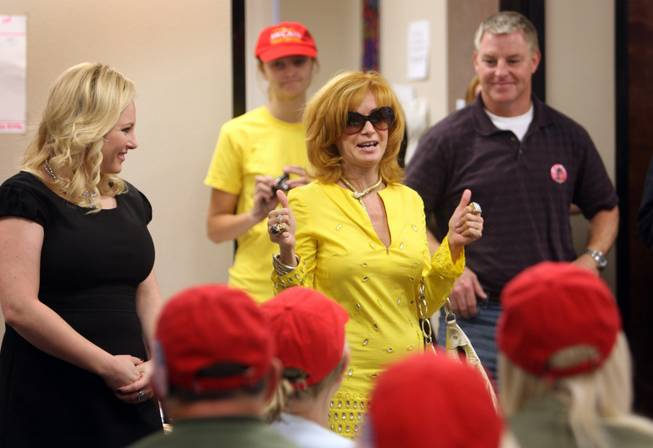 Meghan McCain, left, daughter of Sen. John McCain, visits phone bank volunteers Monday in Henderson, with Linda Ramone, center, and Chuck Heath Jr., Gov. Sarah Palin's brother.