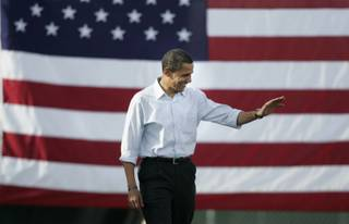 Democratic presidential candidate Barack Obama waves as he takes the stage while making a campaign appearance at Coronado High School Saturday, Nov. 1, 2008.