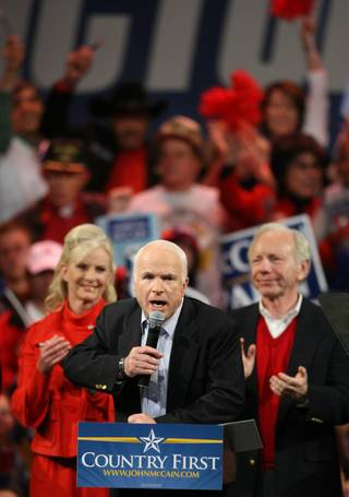 Republican presidential nominee Sen. John McCain, R-Ariz., gives a thumbs-up as he arrives for a rally at the Henderson Pavilion in Henderson, Nev., Nov. 3, 2008.