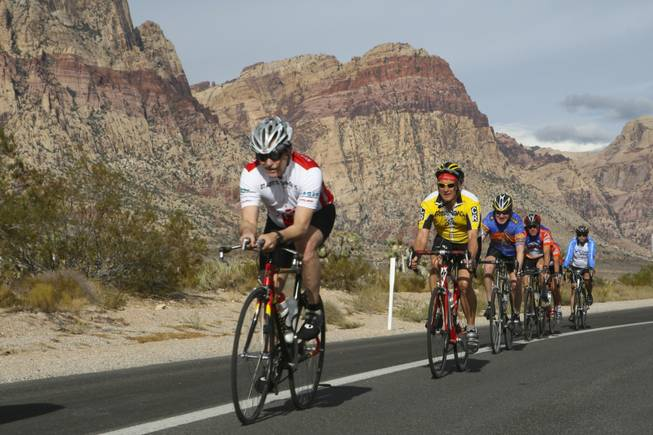 From left, Steven Moore, Jim Haile, Bruce Hanf, Curt Ingle, Donna Ingle, and another cyclist descend the straightaway toward Blue Diamond during the Las Vegas Valley Bike Club's 50-mile Saturday morning ride.