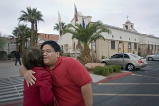 McCain supporter Kristopher Del Campo, hugs Myrna Adad outside St. Joseph Husband of Mary Roman Catholic Church on West Sahara after attending service at the start of his election day.