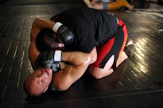 Mixed martial arts fighter Randy Couture, bottom, wrestles with Brice Ritani of New Zealand during an open workout at the Xtreme Couture gym on Wednesday, November 5, 2008. Couture fights Brock Lesnar in an Ultimate Fighting Championship heavyweight championship fight November 15 at the MGM Grand Garden Arena.