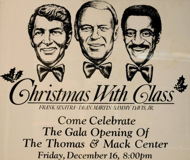 "A poster for a ""Christmas with Class"" concert starring Frank Sinatra, Dean Martin, Sammy Davis Jr. hangs in the halls of the Thomas & Mack Center."