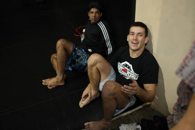 Mixed martial arts fighter Demian Maia, right, talks to reporters during a recent workout at the Xtreme Couture gym in preparation for his UFC 91 match against Nate Quarry Saturday night at the MGM Grand Garden Arena.