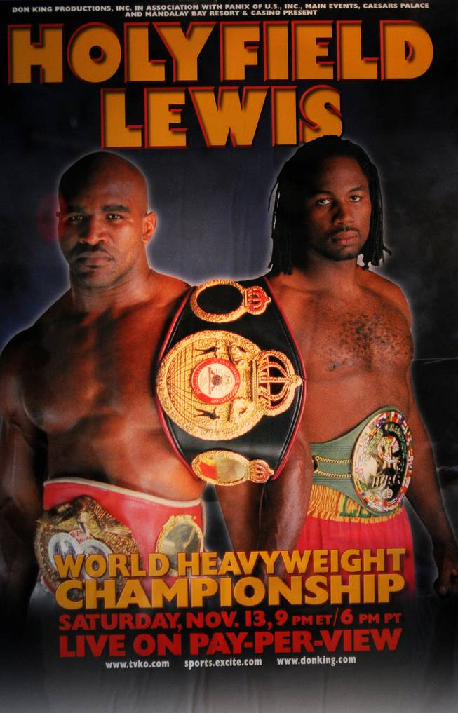 A poster for the heavyweight title fight between Evander Holyfield and Lennox Lewis is displayed inside the Thomas & Mack Center.
